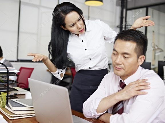 baffled asian businesswoman
